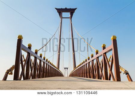 Beautiful bridge across the lagoon against blue sky background