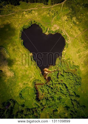 Beautiful heart-shaped lake. Natural heart-shaped lake in the former bend of the river