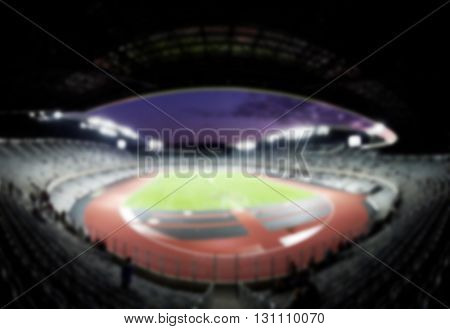 defocused background of soccer or football stadium at twilight