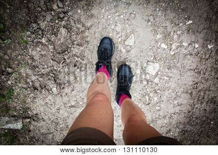 woman hiker legs on mountain path