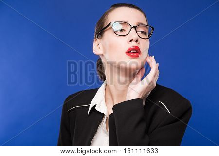 Woman In Glasses With Hand Near Face