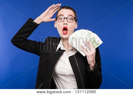 Woman In A Dark Suit And With Money In Hand