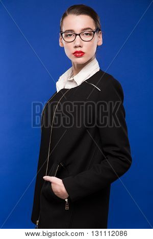 Woman In A Dark Jacket With A Red Lipstick With Glasses