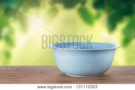An empty bowl on a table with natural background