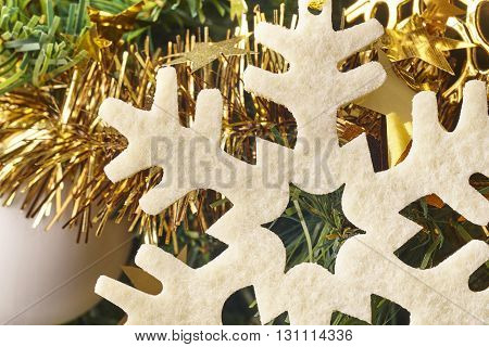 Christmas decoration detail with snow symbol and garland. Horizontal
