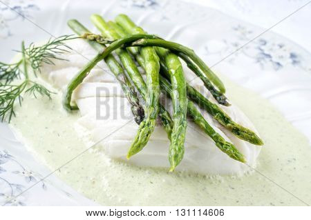 Codfish with Green Asparagus on Plate