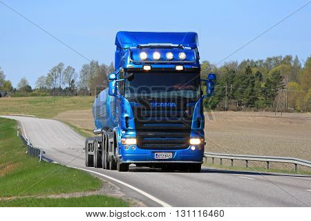 SALO, FINLAND - MAY 8, 2016: Blue Scania R500 tank truck moves along rural road in South of Finland at spring.