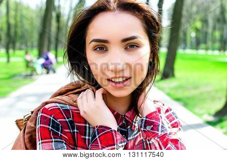 Caucasian young woman outdoors in park portrait in sunny day