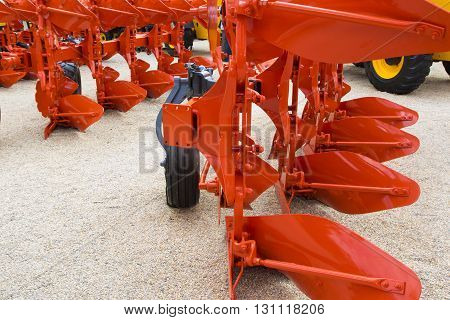 Detail of orange plough for a Farming Tractor
