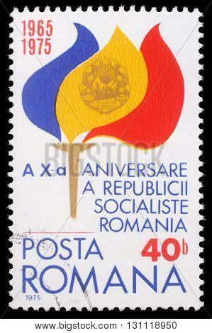 ZAGREB, CROATIA - JULY 19: a stamp from Romania shows Torch with Flame, commemorating 10th anniversary of Romanian Socialist Republic, circa 1975, on July 19, 2012, Zagreb, Croatia