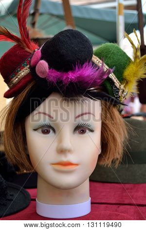 Head of a mannequin with three hats