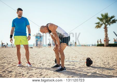 Man making a break while exercising outdoors.