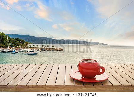 Table With Cup Of Coffee On Harbor Background