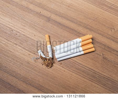 stop smoking Tobacco tear cigarette detrimental on wood background and space for add text above select focus front
