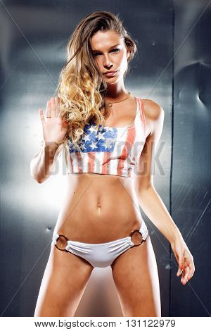 Very sexy girl in a lingerie with American flag