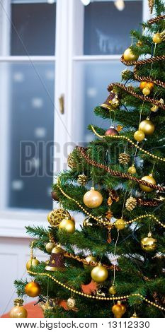 Christmas tree with lights and ornaments at Christmas Eve.?