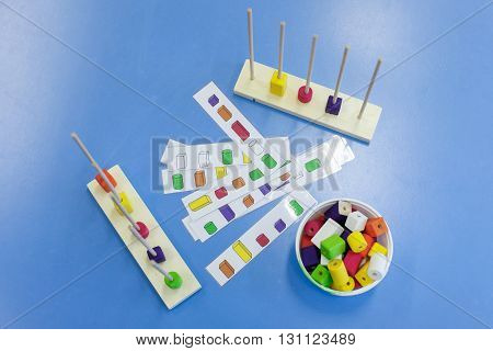 Homemade do-it-yourself educational toys arranging and sorting colors. Learning through experience concept intelligence development educational approach concept.
