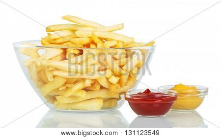 A bowl of French fries and sauces isolated on white background.