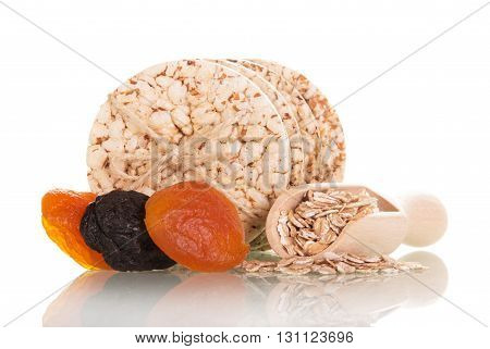 Crackers, dried fruit and oatmeal isolated on white background.