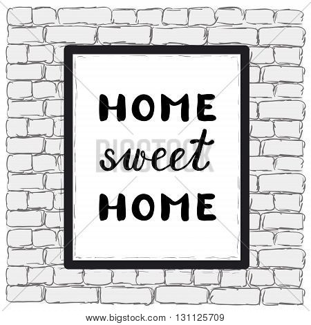 Home sweet home. Poster in a frame on a brick wall. Brush hand lettering. Great for posters home decor and more.