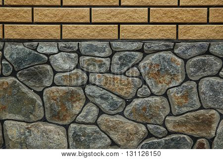 a brick and gray stone wall background