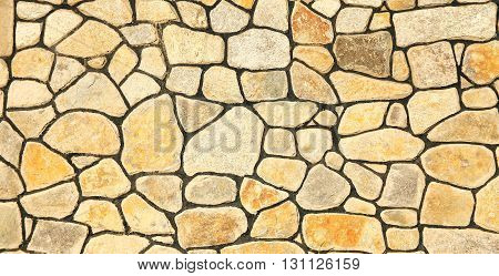 a one a  brown stone wall background