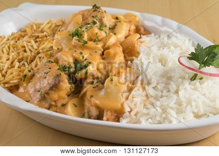 Stroganoff Tilapia Fish with Rice and fries