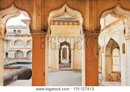 Columns and arches of an ancient palace built in indo-islamic style. 17th century India