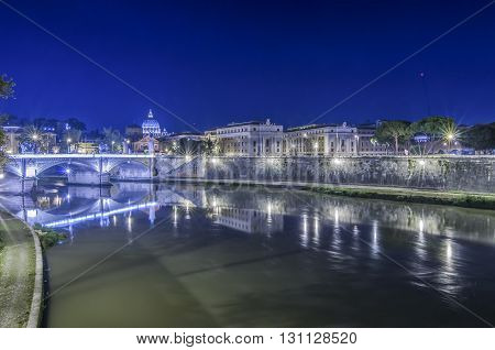 Italy, Rome, - Lungotevere in the night with Saint Peter's Basilica on background