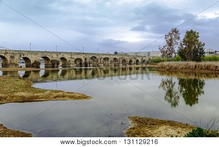 a view of the Puente Romano an ancient Roman bridge over the Guadiana River in Merida Spain
