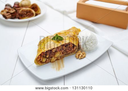 Traditional strudel with figs and nuts sweet healthy dessert on white plate