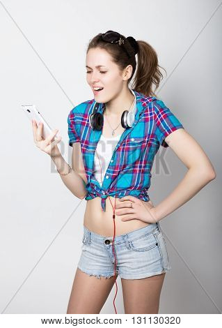teenager girl talking on mobile phone and express different emotions
