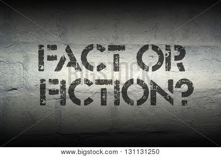 fact or fiction question stencil print on the grunge white brick wall