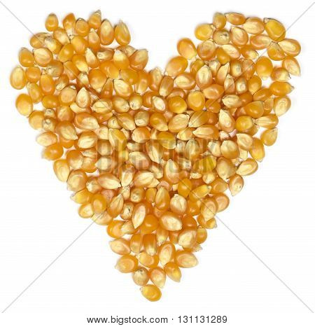 dried corn, heart shape. Isolated on white background.