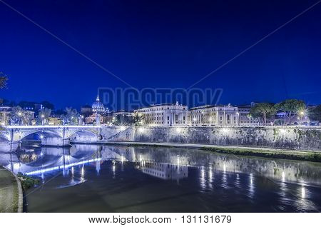 Italy, Rome, - Lungotevere with Saint Peter's Basilica on background.