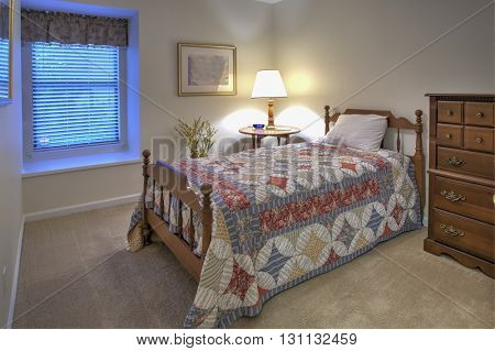 simple guest bedroom with twin bed and quilt
