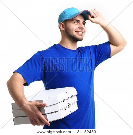 Young man holding pizza isolated on white