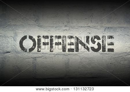 offense word stencil print on the grunge white brick wall