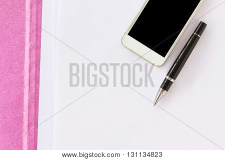 Blank Paper Note With Pen On Business File Folder And Cellphone Background With Copyspace