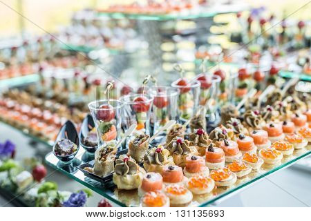 Assortment of canapes. Banquet service.