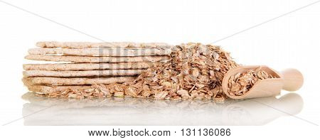 Rolled oats in a wooden spoon and cookies isolated on white background.