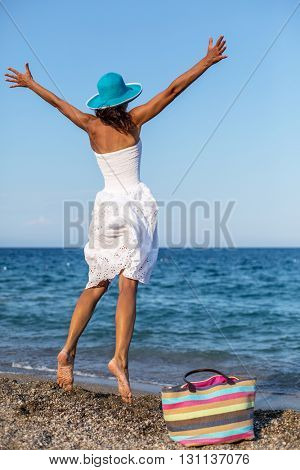 Woman jumping a the seaside.