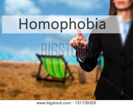 Homophobia - Businesswoman Hand Pressing Button On Touch Screen Interface.