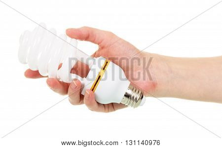 Energy-saving fluorescent spiral bulb in a female hand isolated on white background.