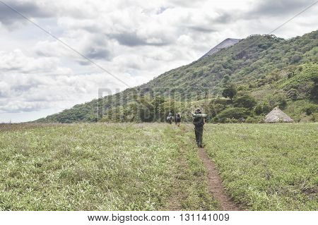 Trail through the fields towards the crater of the very active Telica volcano in San Jacinto near Leon Nicaragua. Matte filter