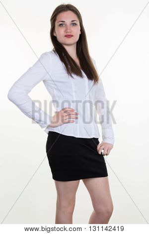 Confident Business Woman With Hands On Hips Against White Background.