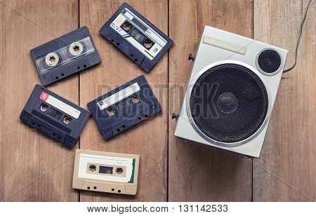Flat Lay Of Cassette Tape And Speaker Laying Down