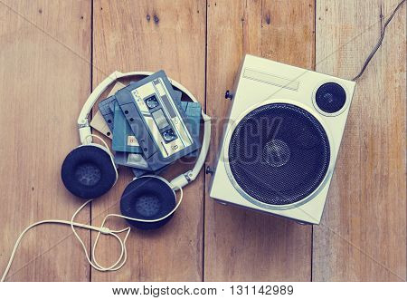 Top View Cassette Tape And Speaker Laying On Wood  Floor