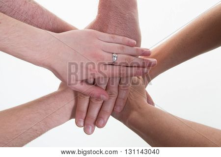 Business People Making Pile Of Hands At Meeting