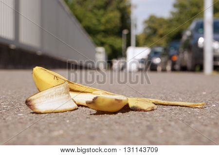 discarded banana skin lying on pavement with selective focus
